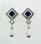14 karat white gold coloured gemstone hand-engraved earrings by Rainbow Sapphire. Set with two princess cut Sapphires and two round cabachon sapphires; 0.90 carat total weight. Accented with two diamonds; 0.07 carat total weight.