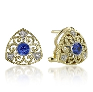 14 karat white and yellow gold; hand engraved; coloured gemstone earrings by Rainbow Sapphire. Set with 2 Blue Sapphires; 0.60 carat total weight. Accented with diamonds; 0.04 carat total weight.