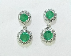 14K white gold emerald and diamond earrings; set with four round green emerald; totaling 0.45 carats and forty G-H SI very good cut round brilliant cut diamonds; totaling 0.18 carats.