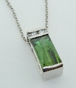 14KW Studio Tzela pendant set with: - 2.75 ct tourmaline - 2 diamonds; 0.087 cttw; G/H; SI