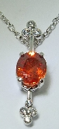 14K White Gold Pendant.  Set with 2.09 carat Spessartite Garnet. Accented with 7 round brilliant cut diamonds; 0.16 carat total weight; SI G/H.