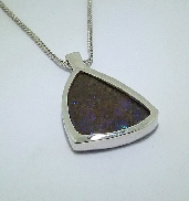 14 karat white gold coloured gemstone pendant; by Studio Tzela. Set with one Blue to Green Ammolite.