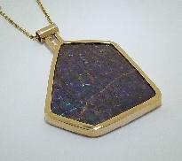 14 karat yellow gold coloured gemstone pendant; by Studio Tzela. Set with a Ammolite.