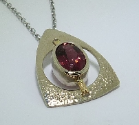 14 karat white and yellow gold coloured gemstone pendant; by Studio Tzela. Set with a 2.344 carat Rubellite Tourmaline.