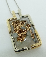 14K white and yellow gold pendant; set with Druzy Agate with 24K yellow plating. Design by Studio Tzela.