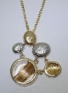 14 karat white and yellow gold coloured gemstone pendant; by Studio Tzela Designs. Set with Rutilated Quartz.