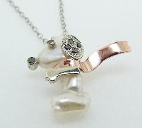 14 KWR pendant by Studio Tzela set with: - Freshwater pearl - 6 black diamonds = 0.125cttw