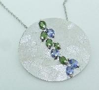 14KW Studio Tzela CG pendant set with: - 4 tanzanite; 0.65cttw  - 5 chrome green tourmaline; 0.75cttw