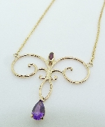 14KY Studio Tzela pendant and chain set with: - 0.63ct Amethyst  - 0.142ct Ruby