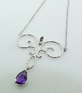 14KW Studio Tzlea CG pendant and chain set with: - 1.10ct Amethyst  - 0.164 ct Ruby