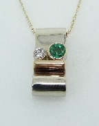 14K white and yellow gold pendant 0.20ct Emerald 0.05ct Diamond H SI1-2 VG cut
