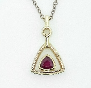 14K yellow gold pendant by Studio Tzela set with: - 0.52ct ruby