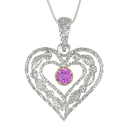14 karat white and yellow gold hand engraved pendant by Rainbow Sapphire. Set with 2 round faceted pink sapphires; 0.25 carat total weight Accented with 9 round brilliant cut diamonds; 0.07 carat total weight; SI1-SI2; G/H.