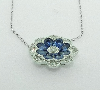 14KW CG pendant set with: - 9 RBC diamonds; 0.25cttw; G/H; SI; very good cut - 8 pear shape sapphires; 1.49cttw