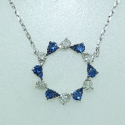 14K white gold pendant set with:  - 12*=0.29cttw diamonds - 12*=0.32cttw sapphires - 18  /16   cable chain