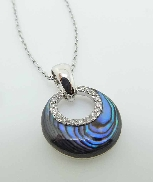 14K white gold round 1.03 carats abalone with 16 G-H VS-SI excellent cut round brilliant cut diamonds loop; totaling 0.08 carats   VENUS CRESCENT MOON  with chain; by Frederic Sage