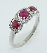 18KW ladies coloured gemstone ring - 3 - 0.71cttw round rubies - 0.12cttw diamonds; G; SI1