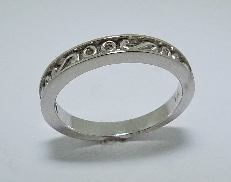 14K white gold lady s wedding band with swirl pattern