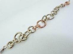 14KWR gold bracelet by Studio Tzela set with: - 16 diamonds; 0.103cttw; F/G; SI1-2; excellent cut - 16 fancy light natural pink diamonds; 0.086 cttw