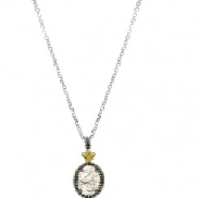 Silver with 18K yellow gold oval pendant with rutilated quartz and black spinel on 18   silver chain.