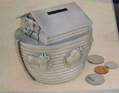 Pewter plated Noah s Ark bank