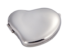 Silver beating heart compact