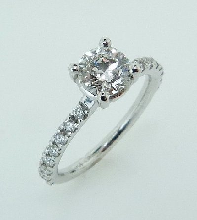 18KW diamond engagement ring set with: - 0.766ct; F; SI1; HOF110802 - 16*-0.31cttw; F/G; VS2-SI1; very good-excellent cut