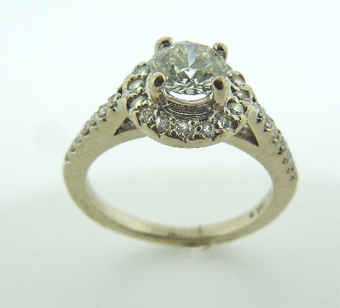 14 karat white gold engagement ring. Set with a 0.530 carat; ideal round brilliant cut Hearts On Fire diamond; I; SI1. HOF71019 Accented with 30 Hearts On Fire diamonds; 0.25 carat total weight; G/H; SI-VS.
