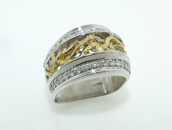 18K white and yellow gold ladies dinner ring set with: - 38 ideal round brilliant cut diamonds by Hearts On Fire; 0.506 carat total weight VS1-VS2; F/G