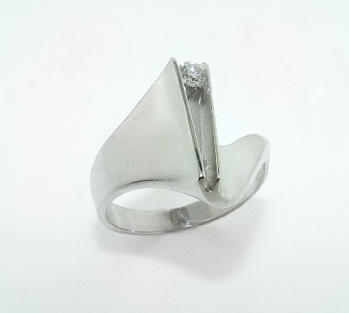 14K white gold custom ring - -set with ideal round brilliant cut diamond by Hearts On Fire; 0.105ct VS-SI;G/H