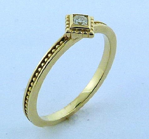 14K yellow gold diamond shaped stackable ring - -set with one Dream cut diamond by Hearts On Fire; 0.093ct VS1-VS2; I/J