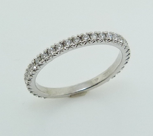 14KW Lady s custom band set with: - - 30 ideal cut; round brilliant cut Hearts On Fire diamonds; 0.262cttw; G/H; VS2-SI1