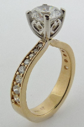 14K Yellow and white gold engagement ring; claw-set with 1 carat CZ . Accented with sixteen F-G SI1-VS2 excellent cut round brilliant cut diamonds; totaling 0.32 carats
