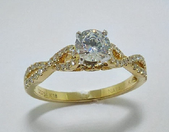 18 karat yellow and white gold engagement ring by Natalie K set with: - 0.50 ct CZ centre - 50 round diamonds 0.25 cttw G/H; VS-SI