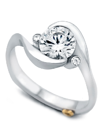 14K white gold engagement ring; known as   Spark   by Mark Schneider. Accented with two round brilliant cut diamnds; totaling 0.035 carats. Center stone is 1.0 carat CZ