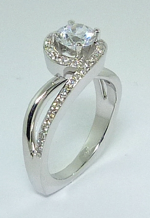 14K white gold engagement ring; by Ancora Set with:     -Center: CZ     - accented with round brilliant cut side diamonds; G/H; VS-SI