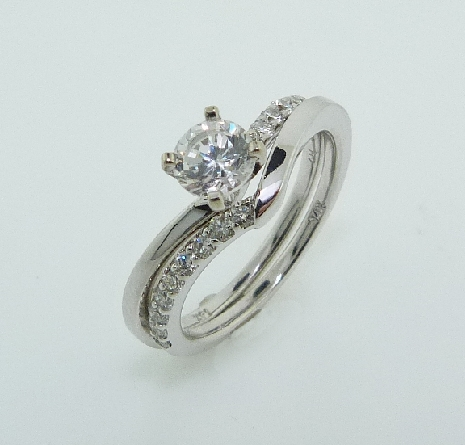 14KW diamond engagement ring and matching band (sold as a set) set with: - - 0.50ct CZ - - 8 RBC diamonds; 0.14cttw; G/H; SI very good cut - - 9 RBC diamonds; 0.16cttw; G/H; SI very good cut