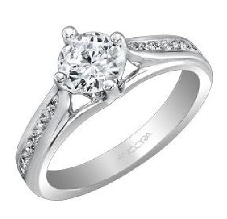 14KW diamond engagement ring set with: - - 1.0ct CZ  - - 18 RBC diamonds; 0.31cttw; G/H; SI very good cut