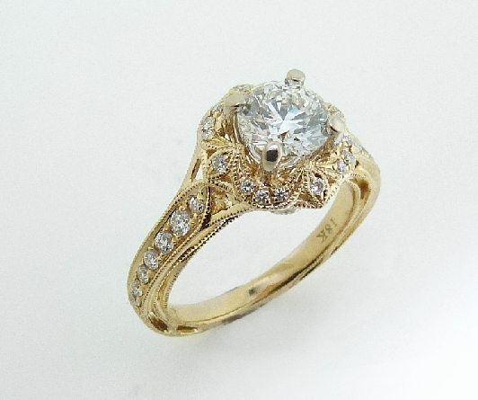 18 karat yellow gold engagement ring; part of the Hera Bridal Collection by Parade Designs. Set with CZ Center. Accented with 30 very good cut diamonds; 0.22 carat total weight; G/H; SI.