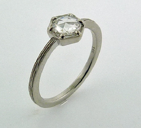 18K white gold engagement ring by Parade; known as Lumiere Bridal; set with 0.51 carat rose cut diamond (5.8 mm).