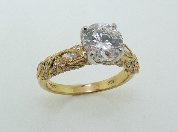 18 karat white and yellow gold diamond engagement ring by Parade set with: - - 4 - marquise diamonds = 0.23 cttw  - - 60 - round brillant cut diamonds = 0.18 cttw -