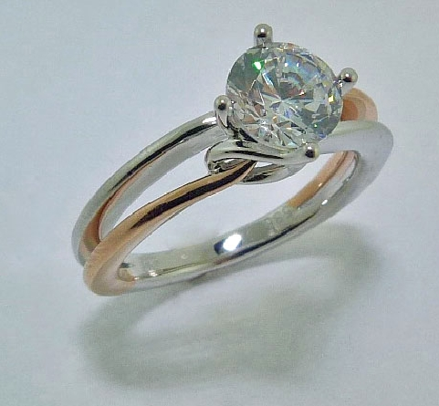14K white and rose gold diamond engagement ring by Frederic Sage; set with:  - 1.00ct CZ center