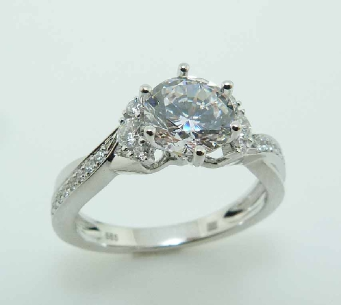 14KW diamond engagement ring by Frederic Sage set with: - 1.0ct CZ  - 38 RBC diamonds; 0.30cttw; G/H; VS-SI