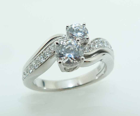 14KW diamond engagement ring by Frederic Sage set with: - 0.50ct and 0.25ct CZ s  - 2 RBC diamonds; 0.04cttw; G/H; VS-SI - 20 RBC diamonds; 0.22cttw; G/H; VS-SI
