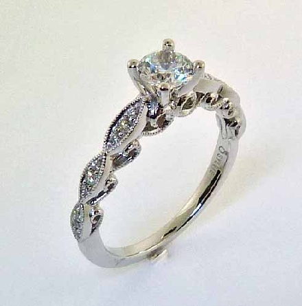 14KW engagement ring by Sylvie set with: - 0.5ct CZ - 18 RBC diamonds; 0.11cttw; G/H; VS-SI