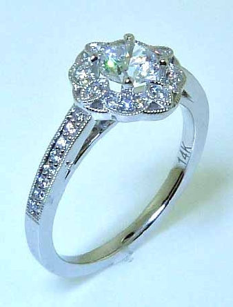 14KW engagement ring by Sylvie Collection set with: - 0.50ct CZ - 0.18cttw RBC diamonds; G/H; VS-SI