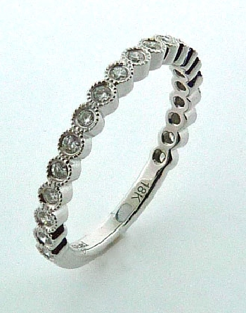 18KW diamond ladies band by Parade Designs set with: - - 20 round brilliant cut diamonds; 0.22cttw; G/H; SI