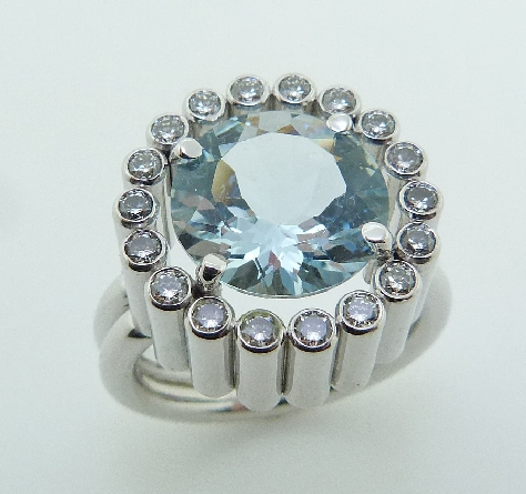 18K white gold custom ring set with: - 18 ideal round brilliant cut diamonds by Hearts On Fire; 0.64 carat total weight; VS-SI; G/H  - 3.567ct round aquamarine.