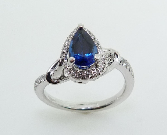 18KW coloured gemstone ring by Parade Designs set with: - 0.95ct pear shaped blue sapphire - 47 round brilliant cut diamonds; 0.26cttw; G/H; SI1-2