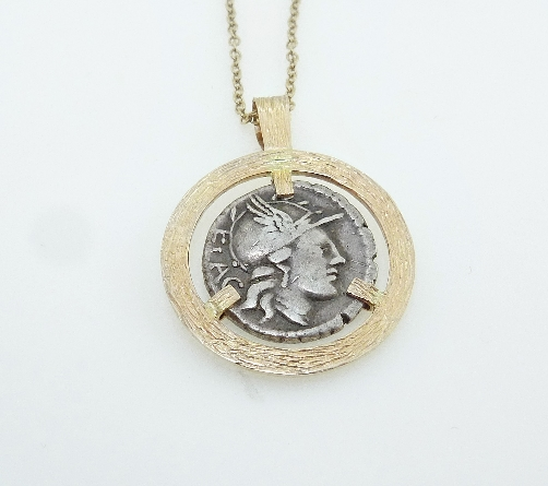 14 KY pendant with barked finish by Studio Tzela set with: - Denarius (denomination of coin) from the Roman Republic         - Circa 75 BC      - Rutilius Flaccus